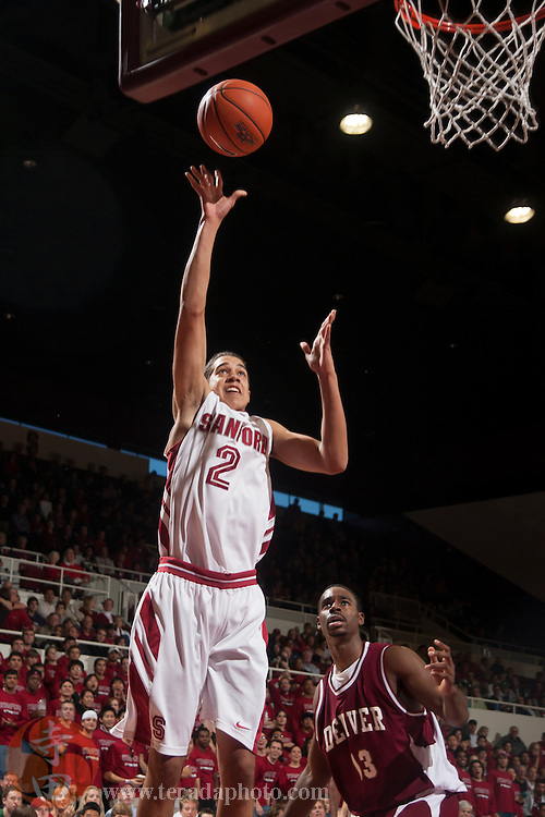 November 25, 2006; Stanford, CA, USA; Stanford Cardinal guard Landry Fields (2) shoots the basketball against Denver Pioneers guard Myke Lattimore (13) during the game at Maples Pavilion. The Cardinal defeated the Pioneers 82-39.