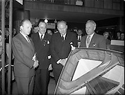 18/04/1960<br /> 04/18/1960<br /> 18 April 1960<br /> The First Annual Boat Show at  Busaras, Store Street, Dublin. Picture shows (l-r): Minister for Transport and Power Erskine Childers and R. Douglas Heard, Chairman of Boatshow and President of Irish Dinghy Racing Association, with the winners of 1st prize for Irish made craft, D.N. Doyle and R. Leonard, Directors of Crosshaven Boatyard Co.  Ltd..