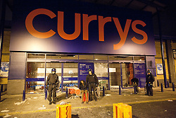 © Licensed to London News Pictures. 08/08/2011. Brixton, UK. Currys in Brixton is smashed and looted during another night of rioting and looting across London. Photo credit : Joel Goodman/LNP
