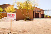 "22 MAY 2011 - SCOTTSDALE, AZ:  A ""No Trepassing"" sign in front of a home reportedly owned by Sarah Palin in Scottsdale, AZ. According to the Arizona Republic, Sarah Palin and her husband Todd Palin, bought the 8,000 square foot home for $1.695 million cash. The newspaper said the Palin's name does not appear on the paperwork and the home was bought by Safari Investments LLC out of Delaware. The paper said the deal ""appears designed to cloak the identity of a high-profile buyer."" The home has six bedrooms, five bathrooms, a six car garage, swimming pool, spa, home theater, wine cellar and children's ""jungle gym"" in the backyard. The home is surrounded by a tall wall with an electronic gate. Phoenix TV stations have reported that a black SUV with Alaska license plates has been seen entering and leaving the compound. People in the house have refused to comment on who owns the home. Neither Palin nor her husband have been seen at the home since news of the sale broke Saturday, May 21.   Photo by Jack Kurtz"