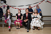 From left Gwen Schmidt, Nikki Mishler, Todd Witt, and Rachel Schmidt sit on the sidelines of the Shermer High School 1986 Spring Dance that's part of the Ferris Fest at the Athletico Center on, Friday, March 20, 2016, in Northbrook. (Photo by Rob Hart)