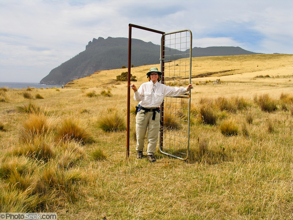 A isolated metal door to nowhere remains in a field on historic Maria Island National Park, Tasmania, Australia.