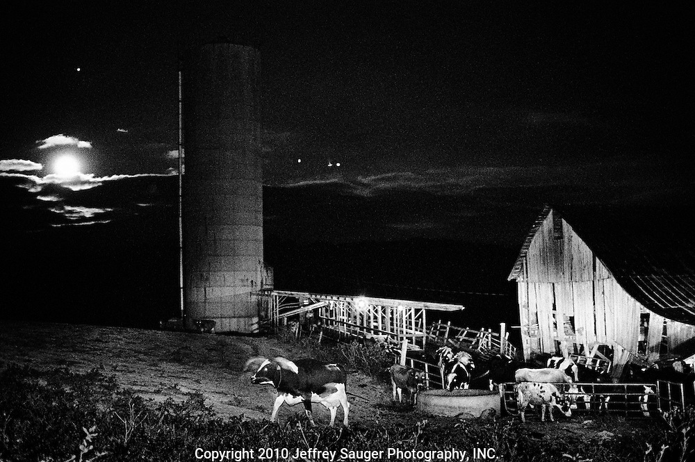 "BIDWELL, OHIO - October 24, 1999: The Harvest Moon rises over Bill and Jackie Howard's 115-acre farm in Bidwell, Ohio on October 24, 1999. In October of 1971 Bill started milking; they raise dairy cows, tobacco, silage corn and hay. ""In 1971 I bought cows for $300-a-piece; I got 40 cows for $12,000. I got into the dairy business for $15,000."" Bill said, ""Now, $15,000 won't get you nothing."" (Photo by Jeffrey Sauger)"