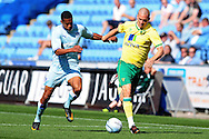 Picture by Alex Broadway/Focus Images Ltd.  07905 628187.30/7/11.Cyrus Christie of Coventry City and Marc Tierney of Norwich City during a pre season friendly at The Ricoh Arena, Coventry.