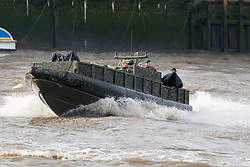 © Licensed to London News Pictures. 23/10/2018. London, UK. Royal Marines in a military vessel travel on the River Thames during a rehearsal for a display tomorrow when the Royal Marines and Royal Netherlands Marines will stage a joint on water capability demonstration with blank ammunition. As part of the Dutch state visit, King Willem-Alexander and Queen Máxima will attend the Dutch ship HNLMS Zeeland, which is anchored next to HMS Belfast. They will join The Duke of Kent on board and will be given a 10 minute display of the Royal Marines and Royal Netherlands Marines staging a joint on water capability demonstration.Photo credit: Vickie Flores/LNP