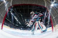 KELOWNA, CANADA - APRIL 30: Michael Herringer #30 of the Kelowna Rockets clears snow from the crease during a time out against the Seattle Thunderbirds on April 30, 2017 at Prospera Place in Kelowna, British Columbia, Canada.  (Photo by Marissa Baecker/Shoot the Breeze)  *** Local Caption ***