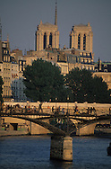 France. Paris. 1st district Art bridge on the Seine river Notre Dame cathedral in the distance / le pont des arts sur la Seine
