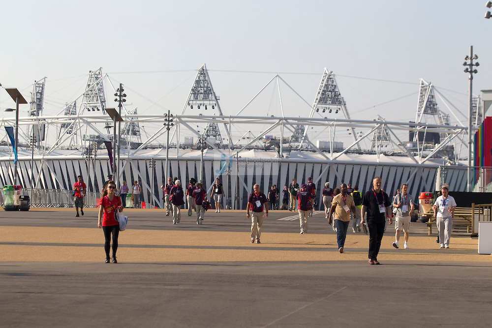 People walk in in front of the Olympic Stadium on July 26, 2012 in London, England. (Jed Jacobsohn/for The New York Times)....