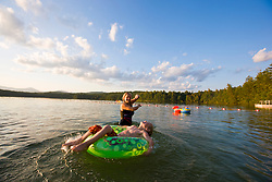 A woman and her son float at the beach at White Lake State Park in Tamworth, New Hampshire.