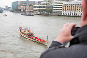 UNITED KINGDOM, London: 09 September 2015 Spectators look on from London Bridge as the Queens rowbarge Gloriana leads a flotilla of boats under Tower Bridge this afternoon to mark the day the Queen becomes Britain's longest reigning monarch. Credit: Story Picture Agency