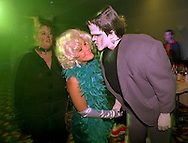 John Stuart as Herman Munster gives a kiss to a woman dressed as Marilyn Munroe during the Sheraton Bucks County's Halloween Party in 1994