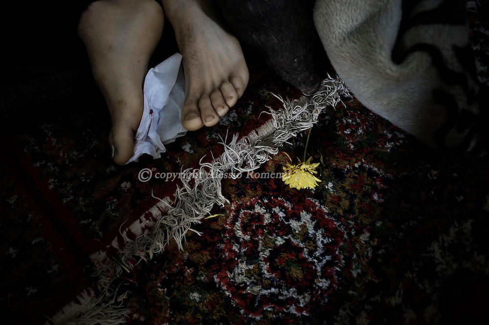 SYRIA - Homs province: The feet of one of the five dead bodies of civilians killed by a mortar explosion in his house, Homs province on February 20, 2012. ALESSIO ROMENZI