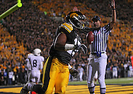 October 2 2010: Iowa Hawkeyes wide receiver Derrell Johnson-Koulianos (15) scores a touchdown on a 9 yard reception during the first half of the NCAA football game between the Penn State Nittany Lions and the Iowa Hawkeyes at Kinnick Stadium in Iowa City, Iowa on Saturday October 2, 2010. Iowa defeated Penn State 24-3.