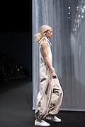 Model walks down the catwolk wearing a dress of Miaoran fashion designer at Armani Teatro, Milan June 18, 2016. © Carlo Cerchioli