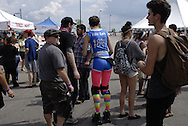 A colurfully clothed woman moves through a small crowd of people at the Riverfront Plaza where Windsor Essex Pride Fest continues after the Pride Parade through downtown <br /> Windsor.