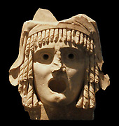 Tragic masks.  Pair of tragic masks, first century BC to first century AD.  A tragic king and a tragic heroine; said to have come 'from a theatre'.  A Roman period rendition in marble of the kind of wooden masks that were worn by actors in classical Greece.