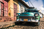 Cuban 1950s green car on street in Trinidad, Cuba