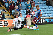 George Ray  and Gary McSheffrey  during the Sky Bet League 1 match between Scunthorpe United and Crewe Alexandra at Glanford Park, Scunthorpe, England on 15 August 2015. Photo by Ian Lyall.