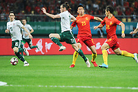 Gareth Bale, left, of Wales national football team kicks the ball to make a pass against He Guan and Wang Shenchao of Chinese national men's football team in the semi-final match during the 2018 Gree China Cup International Football Championship in Nanning city, south China's Guangxi Zhuang Autonomous Region, 22 March 2018.