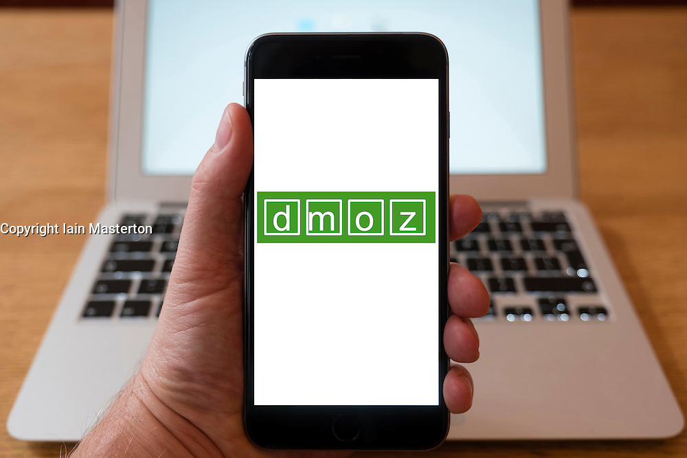 Using iPhone smartphone to display logo of demo , Searchable people-reviewed web directory
