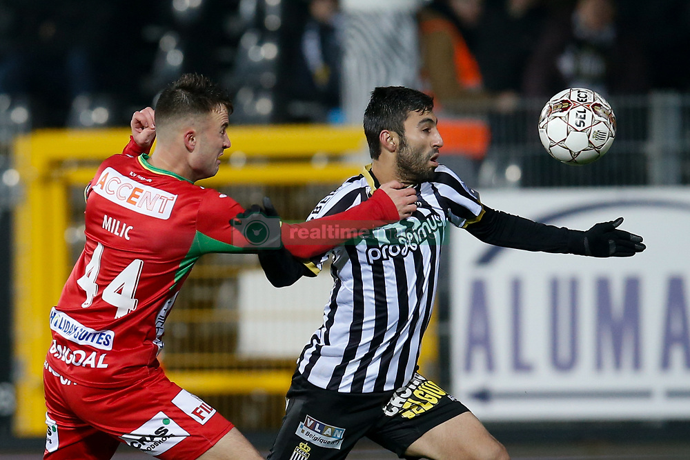 December 1, 2017 - Charleroi, BELGIUM - Oostende's Antonio Milic and Charleroi's Kaveh Rezaei fight for the ball during the Jupiler Pro League match between Sporting Charleroi and KV Oostende, in Charleroi, Friday 01 December 2017, on the day 17 of the Jupiler Pro League, the Belgian soccer championship season 2017-2018. BELGA PHOTO BRUNO FAHY (Credit Image: © Bruno Fahy/Belga via ZUMA Press)
