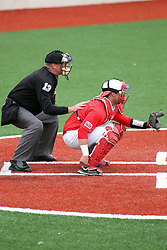 06 April 2013:  Home Plate Umpire Rick Allen places his hand on the back of catcher Mike Hollenbeck as they get ready for a pitch during an NCAA division 1 Missouri Valley Conference (MVC) Baseball game between the Missouri State Bears and the Illinois State Redbirds in Duffy Bass Field, Normal IL