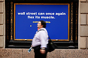 "An ad on Wall Street for New York Sports Club states "" Wall Street can once again flex it's muscles. "" Stocks on Wall Street surge in the morning, reacting to the 117k jobs added in the last week."
