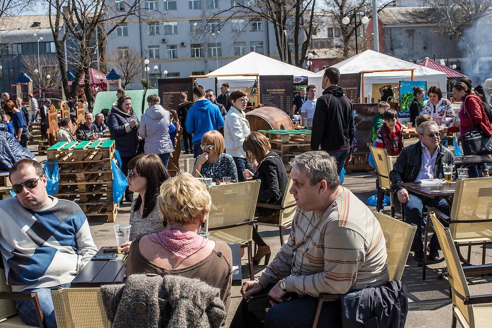 Residents gather for food and drink in a public park on Orthodox Easter on Sunday, April 12, 2015 in Donetsk, Ukraine.