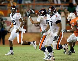 Virginia running back Mikell Simpson (5) catches a screen pass from Virginia quarterback Jameel Sewell (10).  The #19 Virginia Cavaliers defeated the Miami Hurricanes 48-0 at the Orange Bowl in Miami, Florida on November 10, 2007.  The game was the final game played in the Orange Bowl.