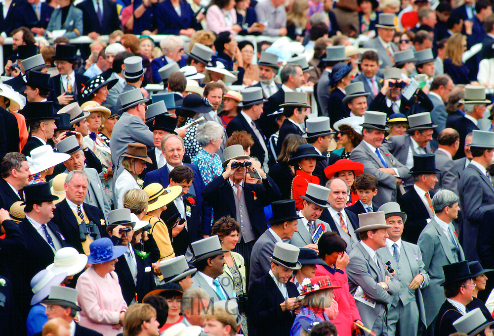 Crowd of racegoers on Derby Day at Epsom Races in Surrey, England