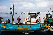 Fishermen on their boat in the early morning, Jaffna, Sri Lanka, Asia