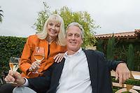 Couple drinking wine in garden portrait