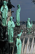 France. Paris elevated view from Notre dame cathedral. The twelve apostles of the spire of Notre dame cathedral