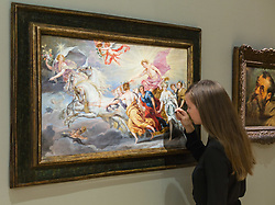 London, July 3rd 2017. Bonhams gallery assistant examines Jan Boeckhorst's Apollo and His Sun Chariot, valued at £60-80,000 in their forthcoming Old Master Paintings sale.