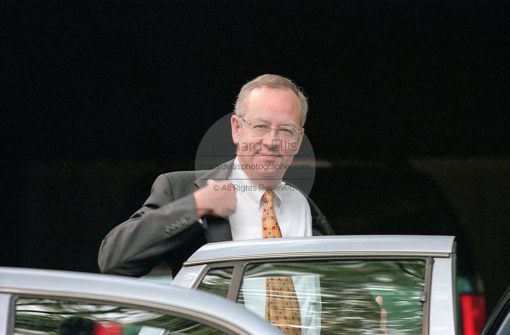 Kenneth Starr, the independent prosecutor investigating President Clinton's affair with former White House intern Monica Lewinsky gets into his car July 29, 1998 at his home in McClean, VA. Starr has agreed to grant immunity to Lewinsky in return for her cooperation in the investigation.