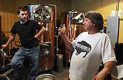 Dave Johnson, head brewer at the Buffalo Brewing Company, checks the quality of one of his beers. Along with Paul Stelmach.