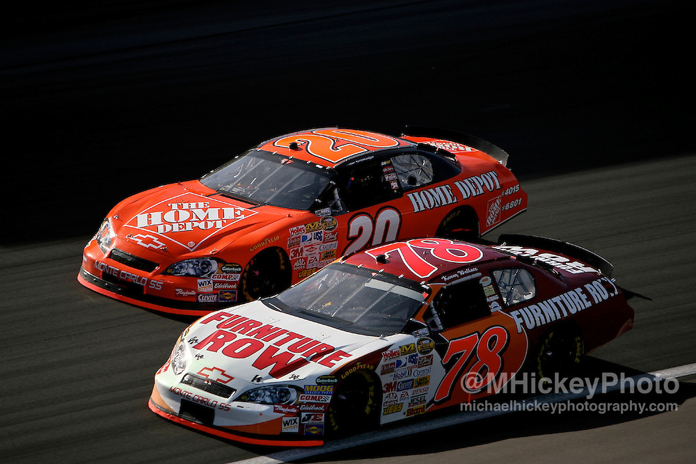 Tony Stewart puts a move on Kenny Wallace early at the UAW Daimler Chrysler 400 at the Las Vegas Motor Speedway on March 11, 2007.