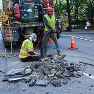 Workmen fixing the melting infrastructure of New York City under a heat index of 106℉ ( 41℃)