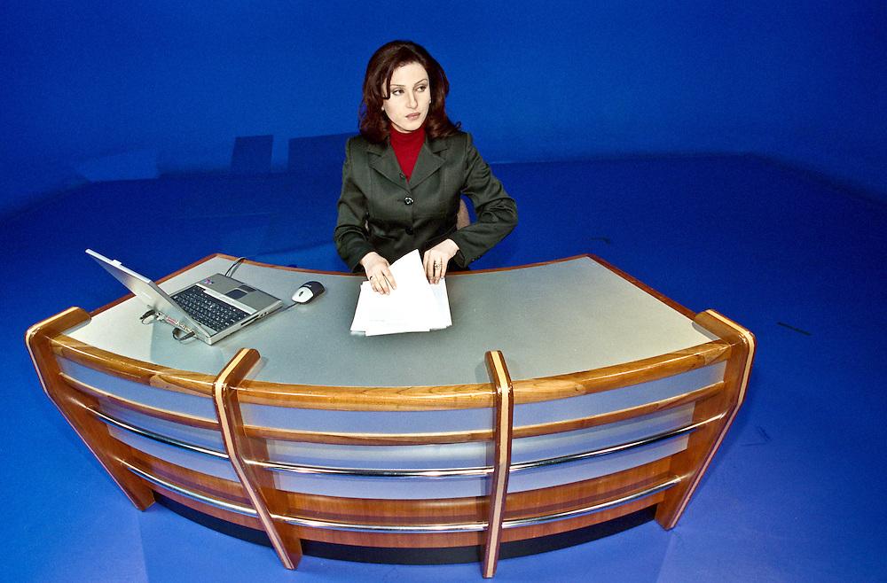 Al Jazeera presenter Jelnar Moussa prepares to broadcast.
