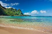 Clear ocean water on the beach amd Bali Hai (Makana) ridge from Tunnels Beach, Kauai, Hawaii