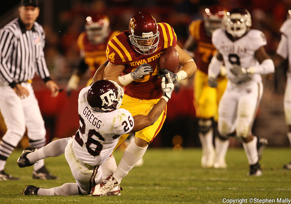 25 OCTOBER 2008: Iowa State tight end Derrick Catlett (84) is hit by Texas A&M defensive back Devin Gregg (26) in the second half of an NCAA college football game between Iowa State and Texas A&M, at Jack Trice Stadium in Ames, Iowa on Saturday Oct. 25, 2008. Texas A&M beat Iowa State 49-35.