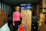 Dominique, 45, teacher in her West London storage. She keeps all her family furniture she was given by her mum, the toys and board games her four daughters used to play with. The cardboards are full of books, old clothes and shoes. She can't throw them away.