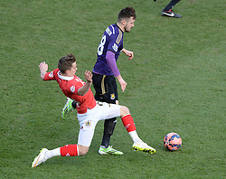 Bristol City's Joe Bryan tackles West Ham's Carl Jenkinson - Photo mandatory by-line: Alex James/JMP - Mobile: 07966 386802 - 25/01/2015 - SPORT - Football - Bristol - Ashton Gate - Bristol City v West Ham United - FA Cup Fourth Round