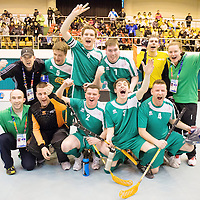 30 January 2013; Team Ireland players James Murphy, Joseph McCarthy, Aidan Cross, Roy Saville, Sean Murphy, William McGrath, Brendan O'Sullivan and George Fitzgerald, and coaches Paul O' Callaghan, back left, Louise O' Toole, and Martin O' Leary, front left, celebrate an 11-1 win over the host nation. Match 2, Division 2, South Korea v Ireland, 2013 Special Olympics World Winter Games, Floorball, Gangneung Indoor Sports Center, Gangneung, South Korea. Picture credit: Ray McManus / SPORTSFILE *** NO REPRODUCTION FEE ***
