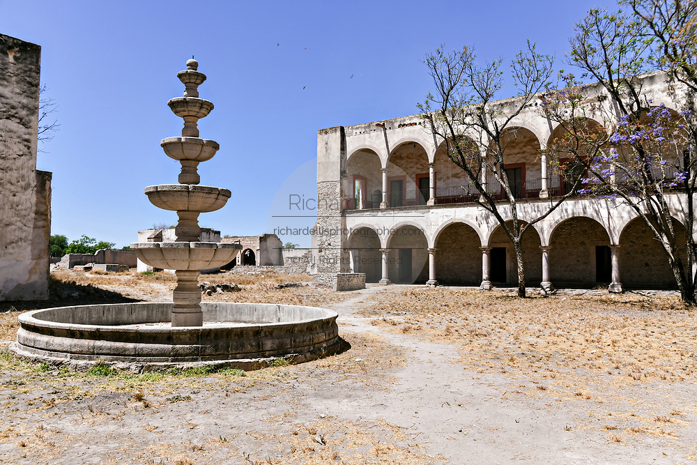 A secondary courtyard and fountain at the fading Hacienda de Jaral de Berrio in Jaral de Berrios, Guanajuato, Mexico. The abandoned Jaral de Berrio hacienda was once the largest in Mexico and housed over 6,000 people on the property and is credited with creating Mescal.