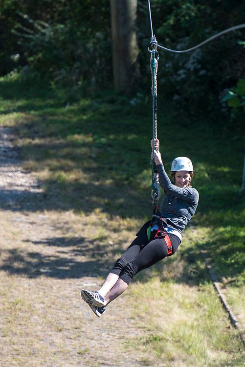 Pamela Gaboury ziplines at the Ohio University Challenge Course at The Ridges. Photo by Hannah Ruhoff
