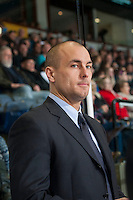 KELOWNA, CANADA - DECEMBER 5: Roman Vopat, Assistant Coach of the Prince George Cougars stands on the bench against the Kelowna Rockets on December 5, 2014 at Prospera Place in Kelowna, British Columbia, Canada.  (Photo by Marissa Baecker/Shoot the Breeze)  *** Local Caption *** Roman Vopat;