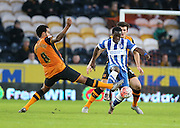 Brighton winger, Elvis Manu (19) and Hull City midfielder Tom Huddlestone (8) during the The FA Cup match between Hull City and Brighton and Hove Albion at the KC Stadium, Kingston upon Hull, England on 9 January 2016.