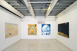 Paintings in a gallery at  Abu Dhabi Art Hub in Abu Dhabi United Arab Emirates