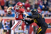 LITTLE ROCK, AR - NOVEMBER 29:  Jack Lindsay #18 of the Arkansas Razorbacks is grabbed while trying to run by Kobie Whiteside #78 of the Missouri Tigers at War Memorial Stadium on November 29, 2019 in Little Rock, Arkansas  The Tigers defeated the Razorbacks 24-14.  (Photo by Wesley Hitt/Getty Images) *** Local Caption *** Jack Lindsay; Kobie Whiteside